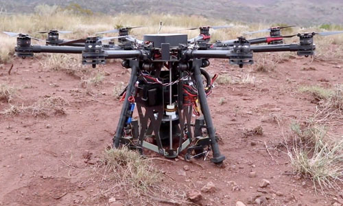 A drone digging a hole in the ground